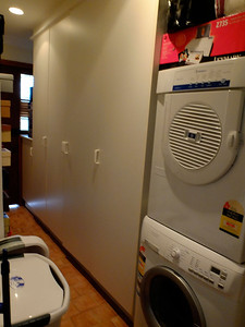 Laundry with storage cupboards