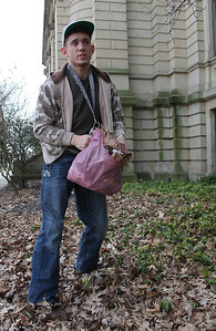 2013_03_10__. Alan Wharton picks up trash along the courthouse as part of  the Elyria Urban Garden Initiative. Alan's group held a cleanup effort for several hours on Sunday, March 10 as part of an effort to promote environmental awareness and urban renewal. photo by Ray Riedel
