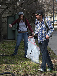 2013_03_10__Sean Nichols, foreground, and K. Davis pickup trash around the downtown courthouse  in Elyria as part of the Elyria Urban Garden Initiative. . photo by Ray Riedel