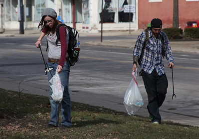 2013_03_10__K. Davis, left, and Sean Nichols, right, participate in the cleanup effort Sunday in downtown Elyria as part of the Elyria Urban Garden Initiative. photo by Ray Riedel