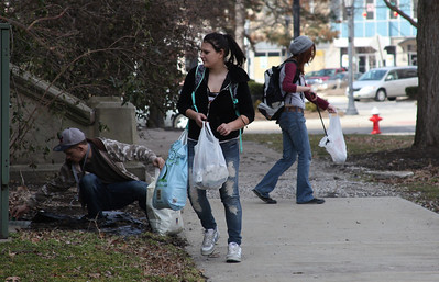 2013_03_10__. Alan Wharton, left, Tiffany Mills, center, and K. Davis, right, pick-up trash around the courthouse in Elyria Sunday as part of an effort to raise environmental awareness and promote urban sustanability as part of the Elyria Urban Garden Initiative organized by Wharton.  photo by Ray Riedel