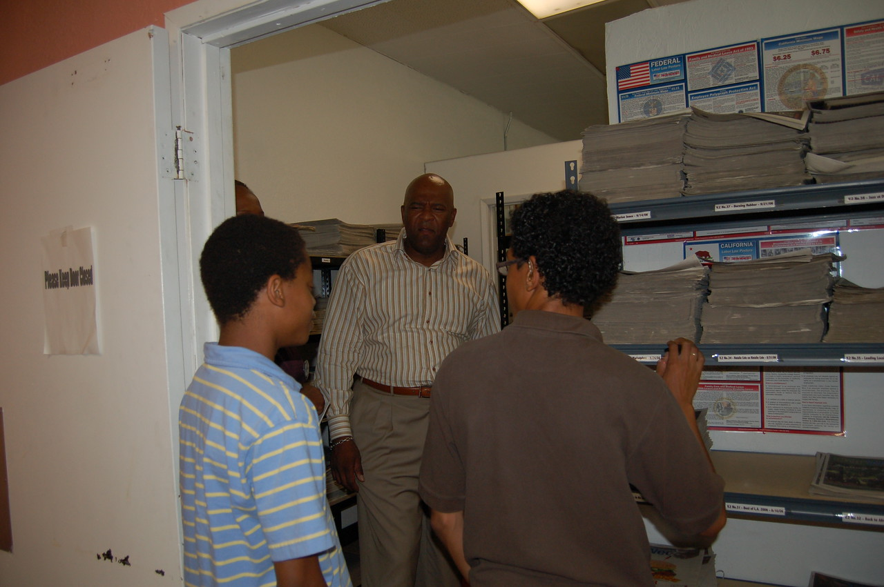 David Miller, co-owner of Our Weekly, a newspaper that serves the African American community, meets the students on their tour of the newspaper.