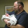 Carol skipped all the medical birthing pictures because they involved blood and boobs and stuff.  None of the nurses are in this public gallery, either.  This is the first pic we have of Andy holding Virginia, about 50 minutes after birth, though he got to hold her about 35-40 minutes after.  (Carol held her until the sewing was done by Dr. Dixon.)