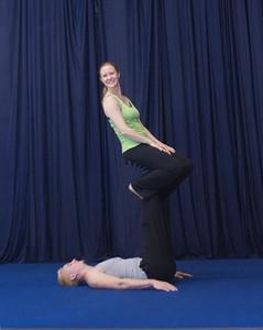 Lying base:  sitting on feet facing back