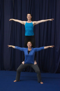 Standing on thighs:  flyer behind base
