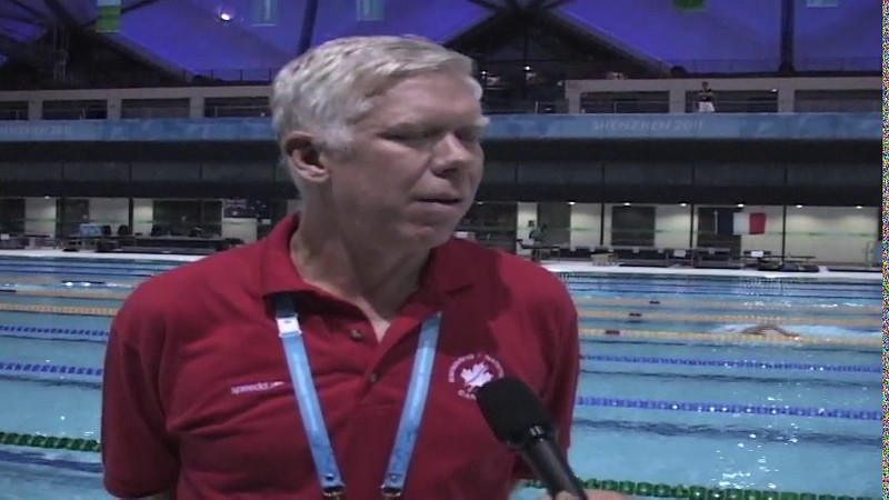 Head Coach Mike Blondal and swimmer Mathew Swanston at the 2011 Summer Universiade in Shenzhen, China - VIDEO: CIS, SendtoNews.com