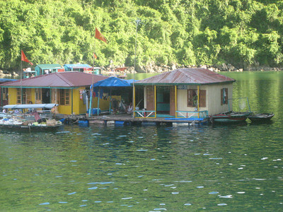 Halong Bay - the yellow boat is a school that awaits a teaching staff