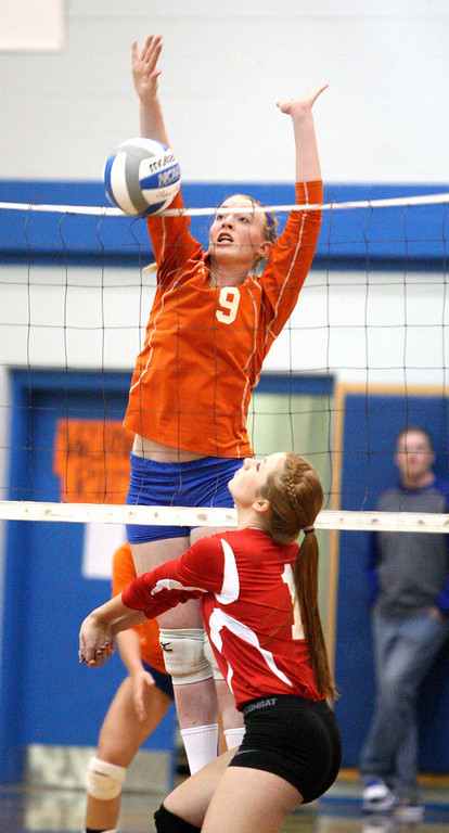 . VVS\' Brandi Edwards (13) puts a shot over the net as Oneida\'s Paige Pickard (9) defends in the first game of the match at Oneida on Thursday, Dec. 4, 2013. Oneida won 3-1.