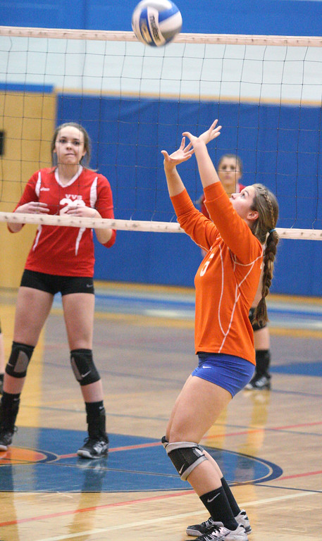 . Oneida\'s Erica Kristan (5) sets the ball as VVS\' Emily Brown (22)  looks on in the first game of the match at Oneida on Thursday, Dec. 4, 2013. Oneida won 3-1.