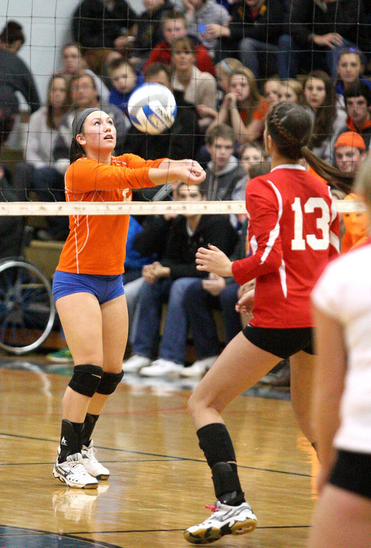 . Oneida\'s Erica Kristan (5) sets the ball as VVS\' Brandi Edwards (13) looks on in the first game of the match at Oneida on Thursday, Dec. 4, 2013. Oneida won 3-1.