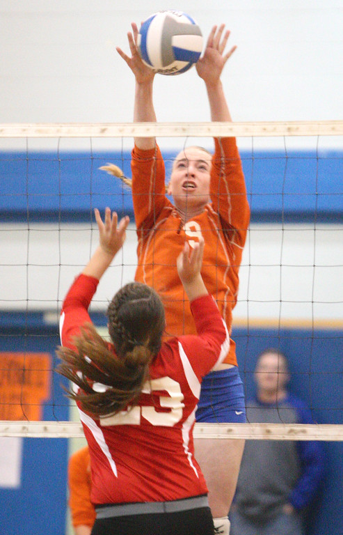 . VVS\' Selena Hass (23) reacts as Oneida\'s Paige Pickard (9) blocks a shot in the first game of the match at Oneida on Wednesday, Dec. 4, 2013. VVS won the first game 25-18.