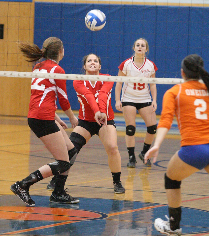 . VVS\' Samantha Kogut (25) set the ball as teammate  VVS\' Emily Brown (22) backs up the play and Oneida\'s Summer Lancette (2) looks on in the first game of the match at Oneida on Thursday, Dec. 4, 2013. Oneida won 3-1.