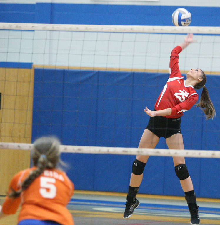 . VVS\' Samantha Kogut (25) puts a shot over the net as  Oneida\'s Erica Kristan (5) defends in the first game of the match at Oneida on Thursday, Dec. 4, 2013. Oneida won 3-1.