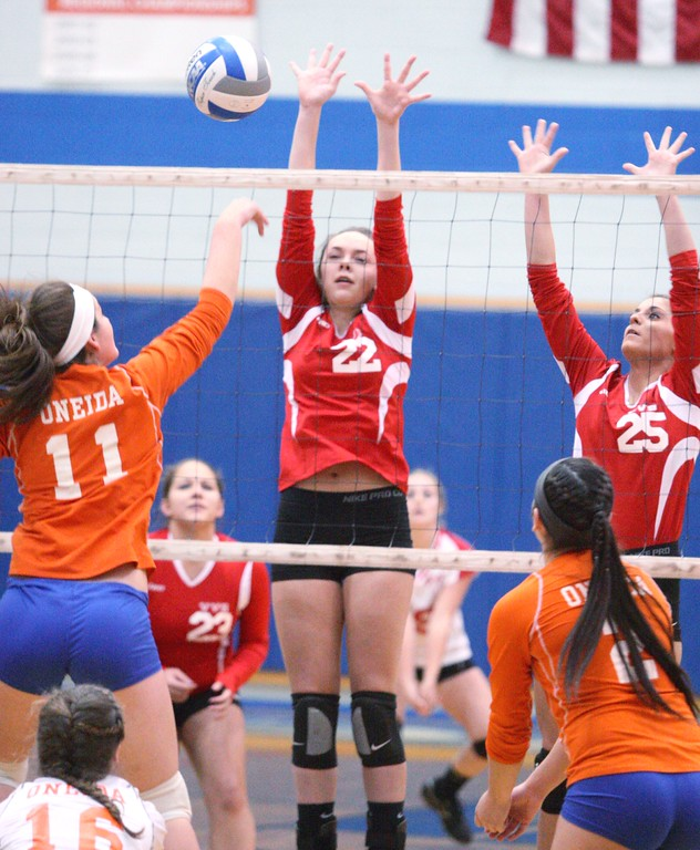 . Oneida\'s Matteson Mair (11) puts a shot over the net as VVS\' Emily Brown (22) and Samantha Kogut (25) defend in the first game of the match at Oneida on Thursday, Dec. 4, 2013. Oneida won 3-1.