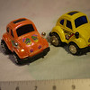 Pull back motorized beetle, yellow and tangerine