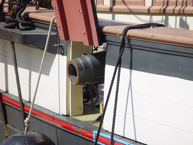 Six Pounder cannons along with swivel guns on railings were the armaments of the privateer.  A privateer is a sort of government sanctioned pirate vessel.