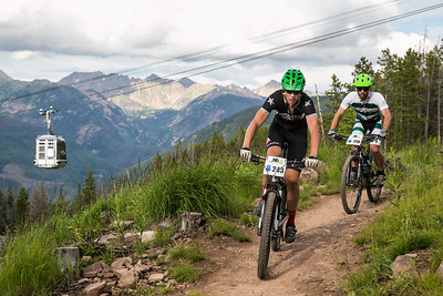 Daniel Huck, front, and Grant Smith, make their way down the Big Mamba trail section of the Vail Grind bike Men's sport race on Wednesday. Three races remain in the The 2015 Vail Beaver Creek Mountain Bike Race Series with the next race taking place on July 22 with the Son of Middle Creek Circuit.