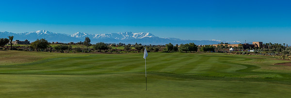 A panorama of the first green looking back towards the clubhouse and Atlas Mountains