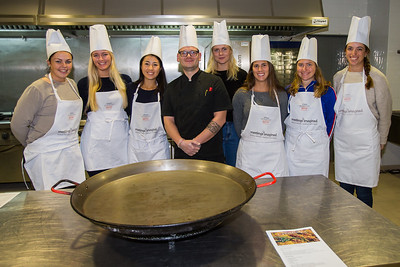 Team 1 pose for a photograph before the paella challenge where two teams of rookies compete to make the best paella