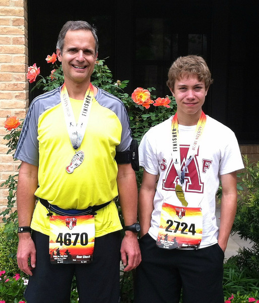Vance and nephew Harrison after finishing the Austin Rock and Roll 10 Mile Run, 2013.