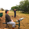 David launching clay pigeons for son Grant at their ranch.