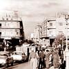 Cars and people walking along Al Rasheed Street in Baghdad