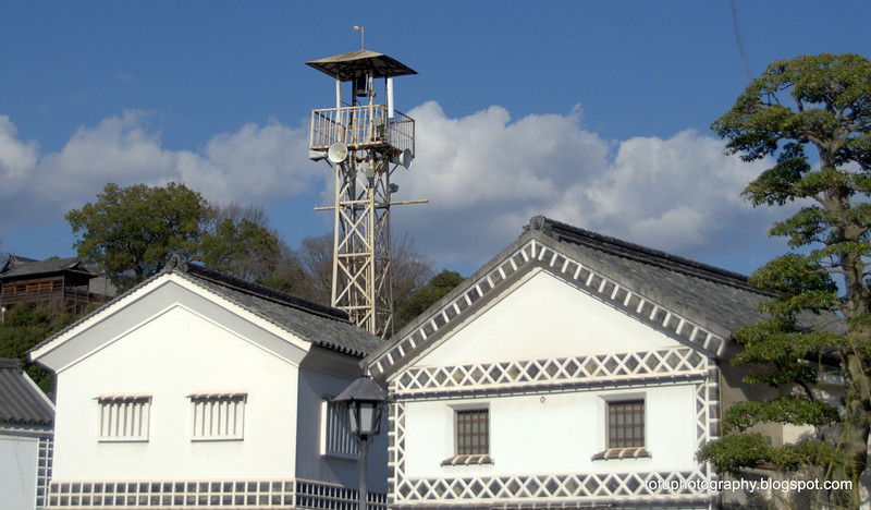 Government building and lookout tower in Kurashiki, Japan in March 2015