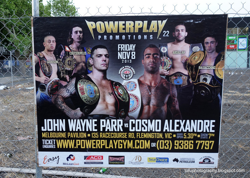Advert for a bout in Melbourne for the World Kickboxing and Karate Association seen in Victoria Street, Richmond, Melbourne in October 2013. John Wayne Parr vs Cosmo Alexandre of a world title bout on 8 November 2013