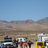 In the distance the pro racers being escorted to the stating line. The tiny blue\red spec midway up and to the left of the picture is the Red Bull Arch marking the start line. Check out the mountains the race course runs through. SWEEEET