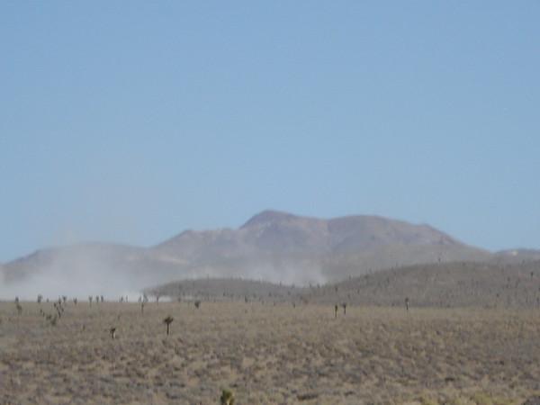 PIc shows racers racing down from the mountains about to pit 3.
