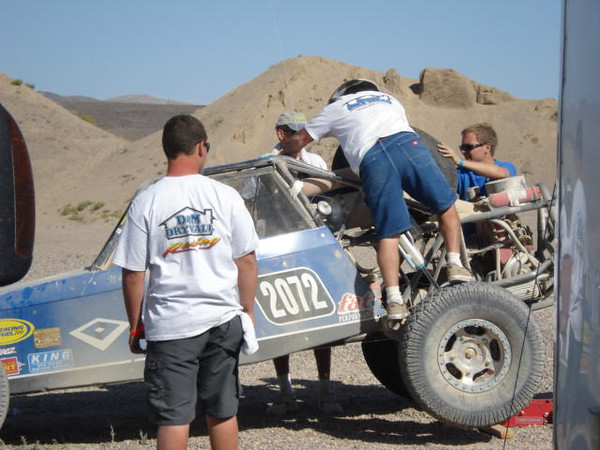 More work from trained pit crews. In pit 3 we saw several tire changes, two transmission changes, and plenty of repair activity. Trany changes often took no more then 15 minutes. Considering all pit work was on dusty dirt desert flooring - it was amazing to watch.