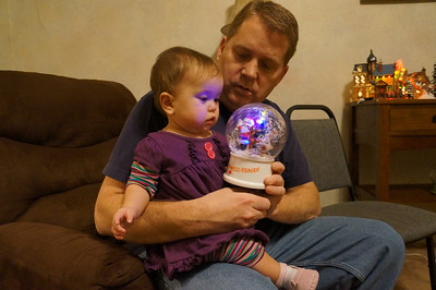 Sophie and her daddy looking at a snow globe