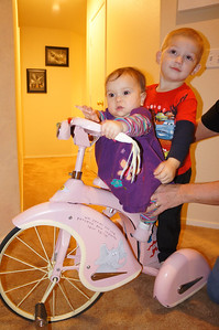 Sophie on her new tricycle from Uncle Mike and Uncle Allen.  Cousin Tavin hitched a ride on the back.