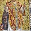 golden mosaic of Saint Nicholas holding his episcopal staff and blessing on the front of st marks basilica in Venice, Italy