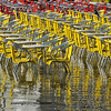 restauant chairs and tables standing in water following a flood