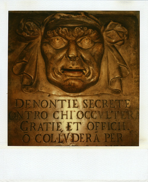 SX-70. Inner Courtyard, Ducal Palace. Secret Denuciation box for the Council of Ten. Notes were placed into the mouth.