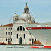a large pleasure cruiser passes through Venice's lagoon, in front of the main sites. Italy