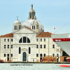 A large pleasure cruiser  passes through Venice's lagoon, bringing many site-seers to the city. Italy