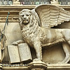 the doge of Venice kneels before the winged lion of Saint Mark, at the Doge's Palace