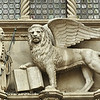 The Doge kneels before the winged lion of Venice representing Saint Mark