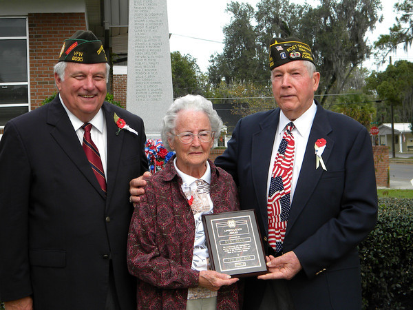 Ms. Ruby Shaw receives her recognition plaque (L-R) Sr. Vice Commander Billy Jackson, Ruby Shaw and Commander Lamar Royals of VFW Post 8095.