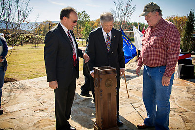 Jim Bible gives a special family heirloom to the Choctaw Nation. Bible presented a newel post from the original Council House to Chief Pyle during the veterans ceremony Nov. 11. Chief Durant had given the post to Bible's grandfather, Curtis Edwin Lewis. The donation is from the Curtis Edwin and Vera C. Lewis estate.
