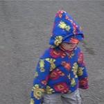 Nathan walking with big fuzzy coat