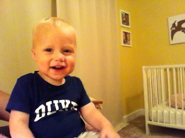 Patrick watches himself make a video on my phone. Waving, blowing kisses, pointing to his nose... but WHERE are those ears?<br /> 17 months old