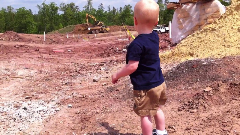 """Watching construction vehicles, playing with rocks, and signing """"truck""""<br /> Patrick - 17 months old"""