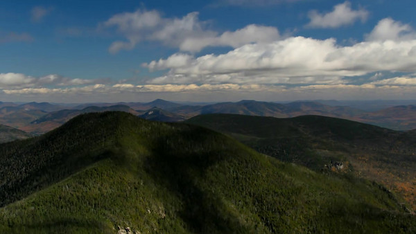 Time-lapse shot from summit of Mount Osceola, NH looking east toward East Osceola peak.  Technical details: Canon 7D, lens Canon 4L 24-105mm IS mounted on mini tripod.  Post processing: Adobe Lightroom 3 & Adobe After Effects.