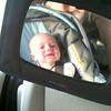 Patrick laughs in his carseat.