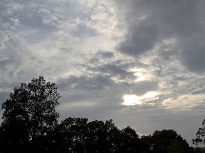 Changeable Weather at Larz Anderson Park, Brookline, MA.  Clouds and the sun battle for the sky.