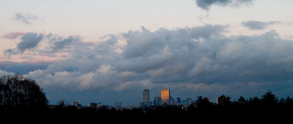 Time-lapse panoramic view of Boston skyline at sunset.  The clouds caught the setting sun while the Hancock tower refuses to relinquish the reflected rays.  Recorded on December 28, 2009 from Larz Anderson Park, Brookline, MA.  Images cropped to 2.35 aspect ratio, presented at 10 fps.
