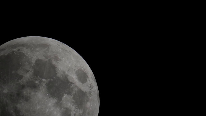 """Thunder Full Moon over New Jersey. DSLR Video image taken with a Nikon D3s and Questar 7"""" telescope. Video image processed with Adobe CS5 Premier Pro."""